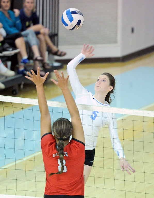 Miranda Ghallagher jumps for a spike against Casper College on Tuesday, Sept. 27 at the Bruce Hoffman Golden Dome. Mike Pruden | The Sheridan Press