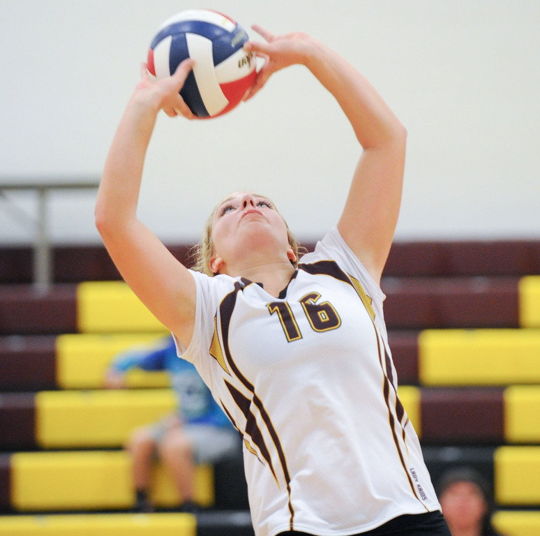 Mike Dunn | The Sheridan Press. <br /> Abby Buckingham sets the ball Saturday against Wright.