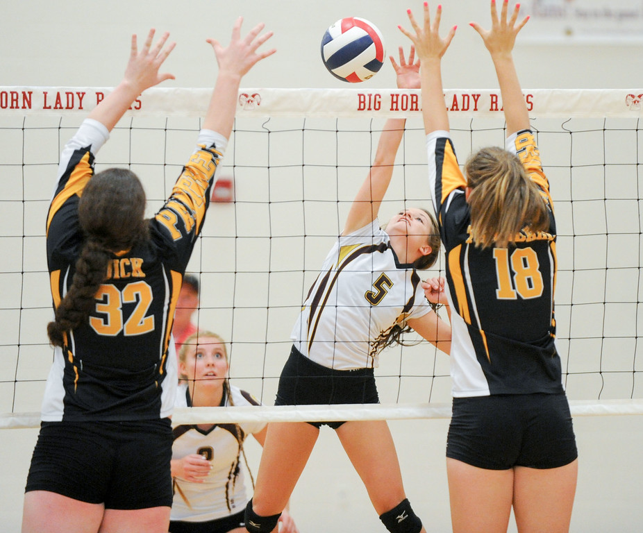 Mike Dunn | The Sheridan Press. <br /> Sydney Atkinson, middle, goes for a kill Saturday against Wright.