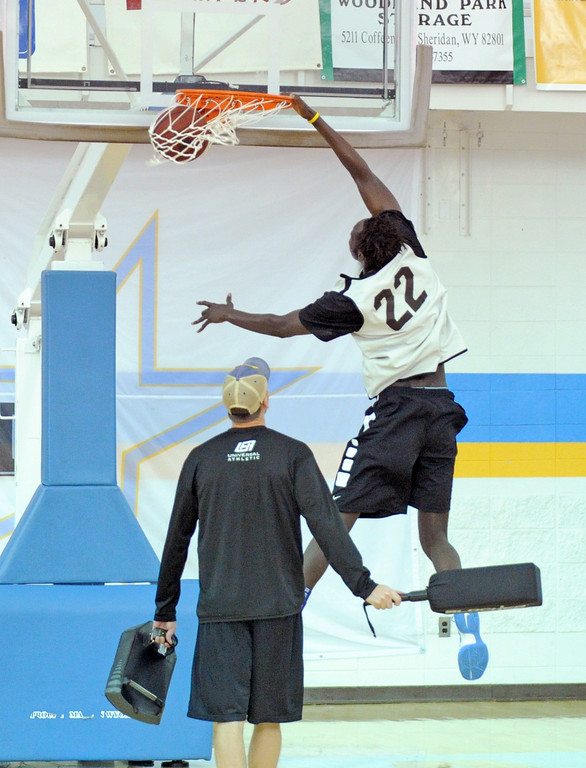 Fa Dieng throws down a dunk during practice on Saturday, Oct. 1 at the Bruce Hoffman Golden Dome. Mike Pruden | The Sheridan Press