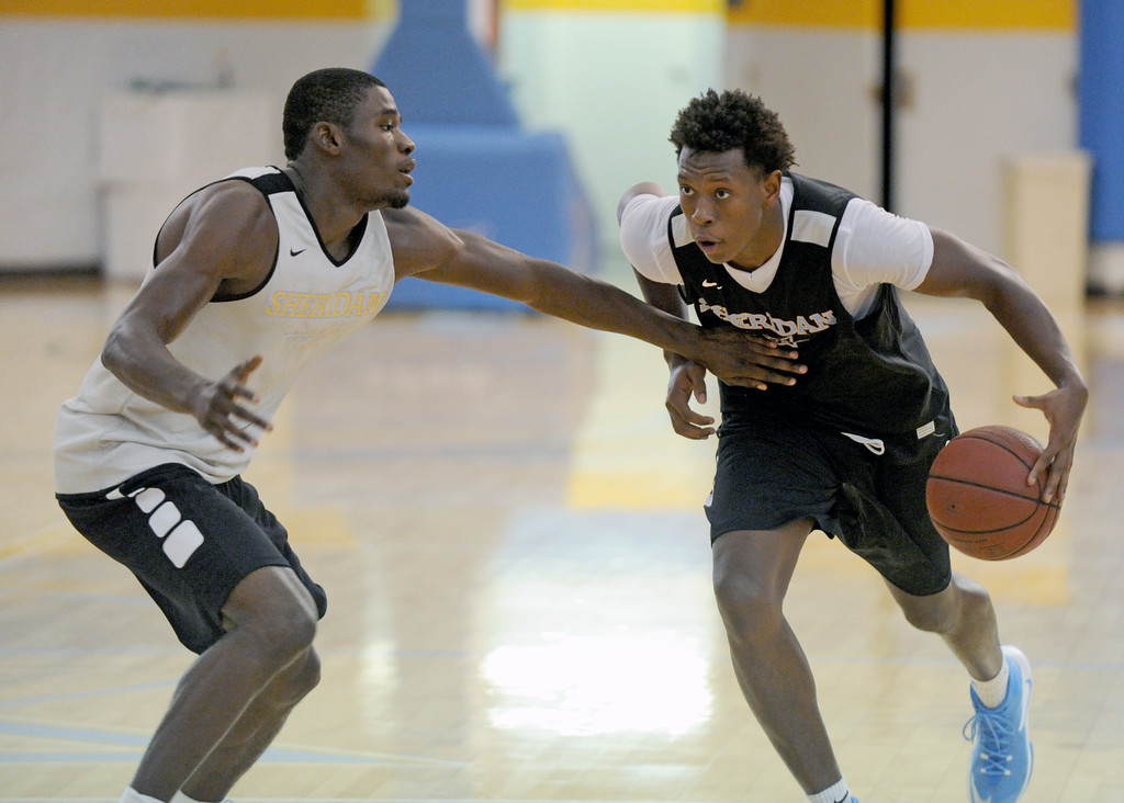 Austin Sherrell, right, drives at Dmonte Harris during Sheridan College's first practice on Saturday, Oct. 1 at the Bruce Hoffman Golden Dome. Mike Pruden | The Sheridan Press