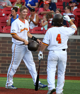 8-3-16 Jackrabbits vs Miners Connor Dall smiles after crossing home and is congratulated by teammate Logan Barnes. Kelly Lafferty Gerber | Kokomo Tribune