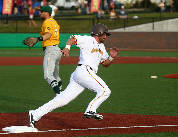 8-3-16 Jackrabbits vs Miners Mitch Stoltzfus rounds third and heads for home to score a run. Kelly Lafferty Gerber | Kokomo Tribune