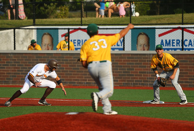 8-3-16 Jackrabbits vs Miners The Miners' pitcher tries to pick Cole Nieto off first. Kelly Lafferty Gerber | Kokomo Tribune