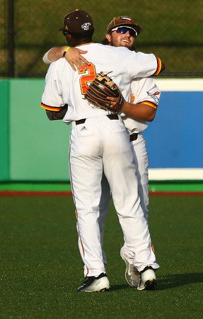 8-3-16 Jackrabbits vs Miners Logan Barnes hugs Lance Mays in the outfield. Kelly Lafferty Gerber | Kokomo Tribune