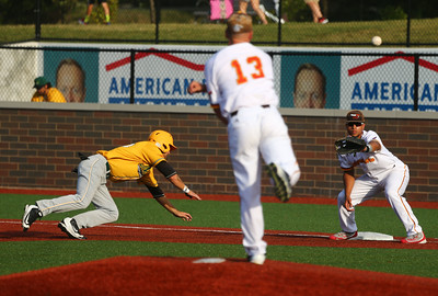8-3-16 Jackrabbits vs Miners Trey Bickel tries to pick Miner's 35 off first by throwing to Matt Owens. Kelly Lafferty Gerber | Kokomo Tribune