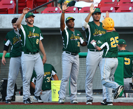 8-7-16 Jackrabbits vs Miners Jeremy Schreiber is congratulated by his teammates after scoring the first run for the Miners. Kelly Lafferty Gerber | Kokomo Tribune