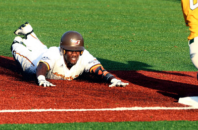 8-3-16 Jackrabbits vs Miners Lance Mays slides into third safely. Kelly Lafferty Gerber | Kokomo Tribune