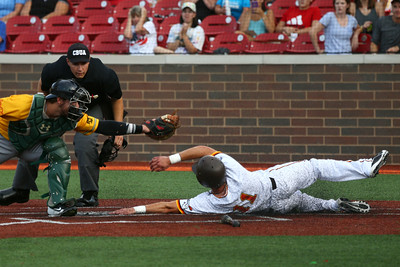 8-3-16 Jackrabbits vs Miners Mitchell Stoltzfus slides home safely just out of reach of the Miners' catcher. Kelly Lafferty Gerber | Kokomo Tribune