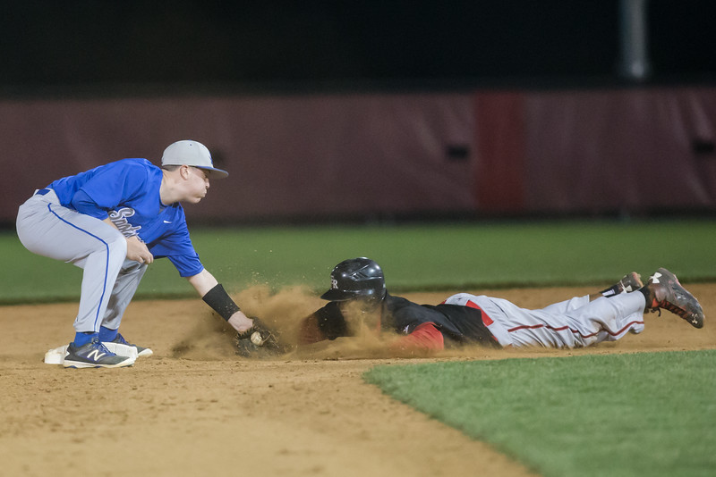 ERHS' Javon Butler slides in to second base and tagged out.