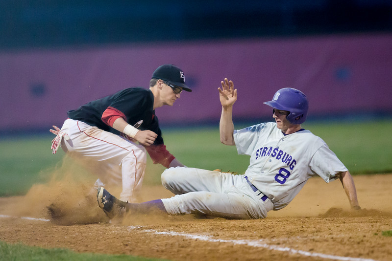 Jayson Cross tries to tag Strasburg's Brian Scholten out as he slides in to third base.
