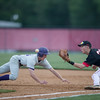 Collin Dean tries to get an out after a Stasburg player leads off of first.