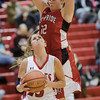 Natile Jenkens looks to go up for a shot as Emma Casto comes in over top of her.