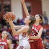 Ali Berry lays the ball up against Faith Christian