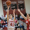 Lexi Dean goes for a jumpshot as Emma Casto tries to block