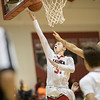 Zach Hall goes in for a layup.