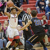 Javon Butler looks for an open teammate as Jared Rice guards