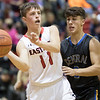 Luke Myers passes the ball while being guarded by Mason Marston.