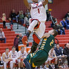 Javon Butler leaps over Jacob Floyd enroute to the basket