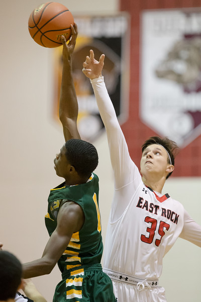 Zach Hall and Nelson's Cory Poindexter go for the jump ball
