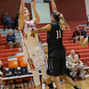 Madison Shifflett puts the ball up over Sara Sabo.