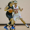 Natile Jenkins guards Lee'sAmber Johnson