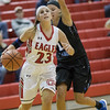 Natile Jenkins cuts around Sara Sabo enroute to the basket.