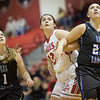 Catherine Orndorff battles against Mary Elam and Whitneyt Darby after a foul shot.
