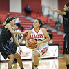 Norma Morris goes in for a layup past Kemper Snyder and Ciniya Crawford.