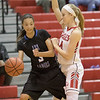 Madison Shifflett puts pressure on Ciniya Crawford as Lee inbounds the ball.