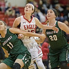 Lexi Dean battles with Nakaila Gray and Kailey Landis for a free throw rebound.