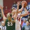Naomi Gibson goes in for a layup against Destiny Ritchie