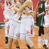 Meredith Deand and Madison Shifflett hug each other after their victory