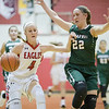 Madison Shifflett brings the ball down court guard by Faith Funkhouser