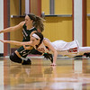 Lexi Dean and Faith Funkhouser reach for a loose ball
