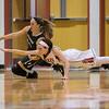 Lexi Dean and Faith Funkhouser reach for a loose ball