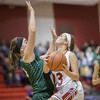 Natalie Jenkins pushes in for a layup against Kailey Landis