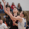 Meredith Dean goes up for a shot against  Makayla Taylor
