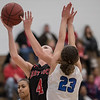 Madison Shifflett goes up for a lay up as Abi Tanner attempts to block
