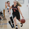 Haley Cave brings the ball down court