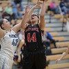 Naomi Gibson goes up for a layup as Laney Corbin attempts to block