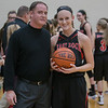 Madiison Shifflett and Coach Comer pose for a picture after Madison reaches the 1,000 point mark.