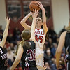 Lexi Dean towers over the Bulldogs defense for a shot.