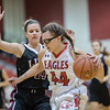 Naomi Gibson drives to the basket past Allie Weakley