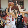 Kaitlyn Todd powers up for a shot under the basket drawing the fowl from Jailyn Dellinger