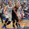 Casey Irvine and Lexi Dean battle for a rebound after a foul shot.