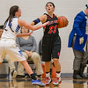 Natile Jenkins looks for help from her teammates as Addiston DeLucas guards her.