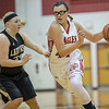 Naomi Gibson drives in past Caitlin Hensley