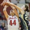 Naomi Gibson takes a fowl unde the basket from Leah Calhoun