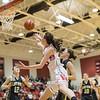 Lexi Dean forces a shot under the basket